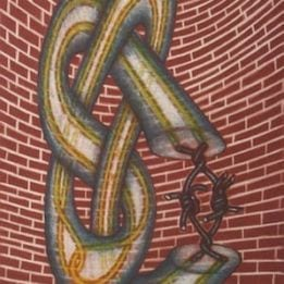 Twisted Up Against A Red Brick Wall